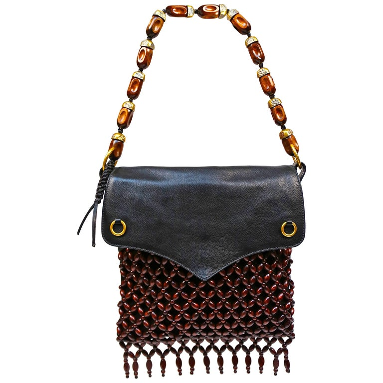 Yves Saint Laurent black suede and leather bag with fringed wood beading For Sale