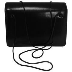 Judith Leiber glazed black calf flap front snake chain handle evening bag