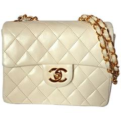 Vintage CHANEL white lambskin flap chain mini shoulder bag, classic 2.55 purse.
