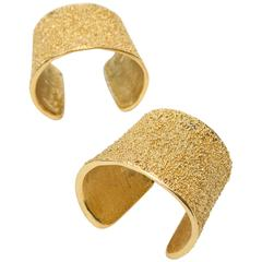 Pair of Signed Yves Saint Laurent Textural Gold Plated Cuff Bracelets