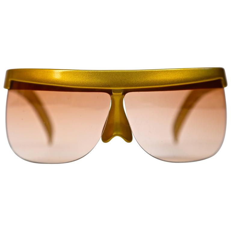 1970's COURREGES gold plastic sunglasses 1