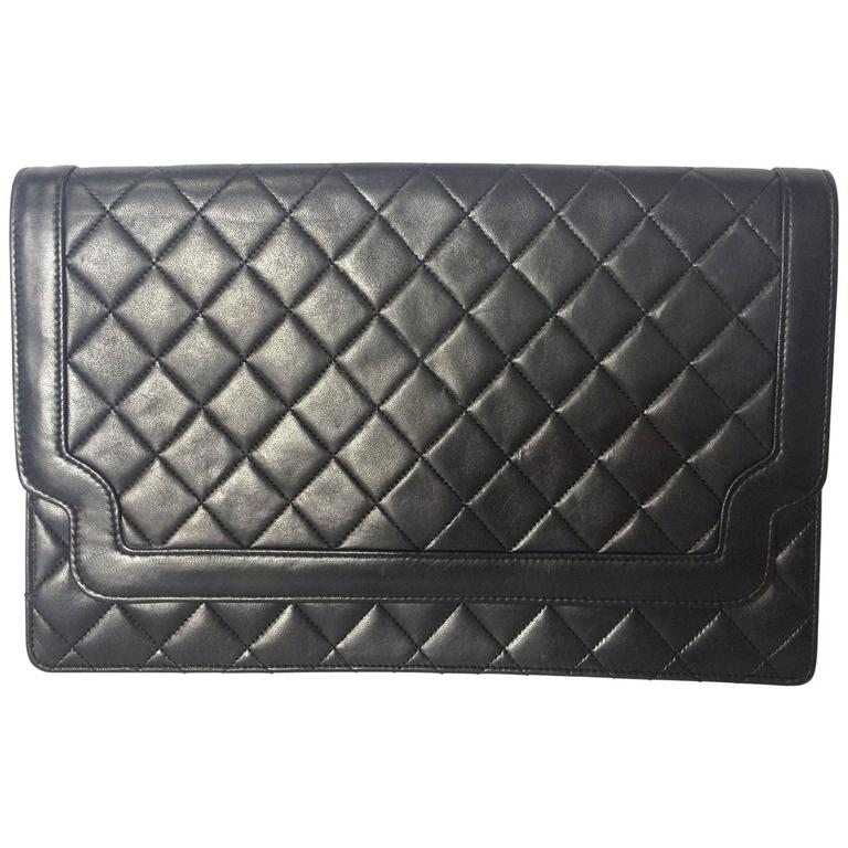 Vintage CHANEL classic black quilted lambskin document clutch purse. Classic bag 1