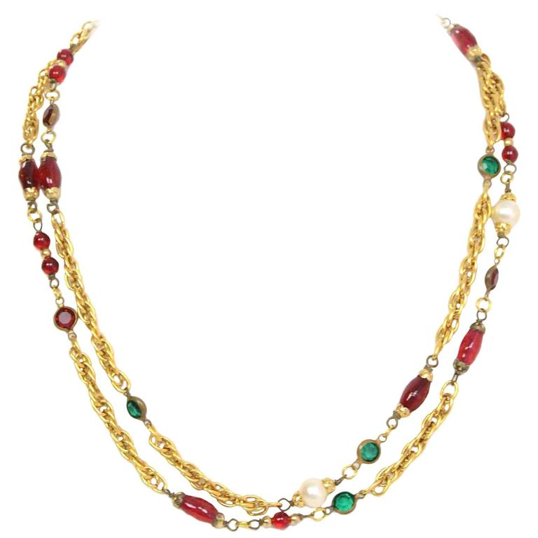 Chanel Gripoix & Pearl Long Strand Necklace Features red gripoix, red and green crystals and faux pearls throughout Made in: France Year of Production: 1984 Color: Red, green, ivory and goldtone Materials: Strass crystals, gripoix, metal,
