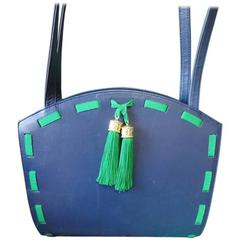 Vintage MOSCHINO navy leather tote bag with green tape trimming and fringes.