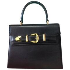 Vintage Gianni Versace black leather Kelly style bag with golden buckle closure