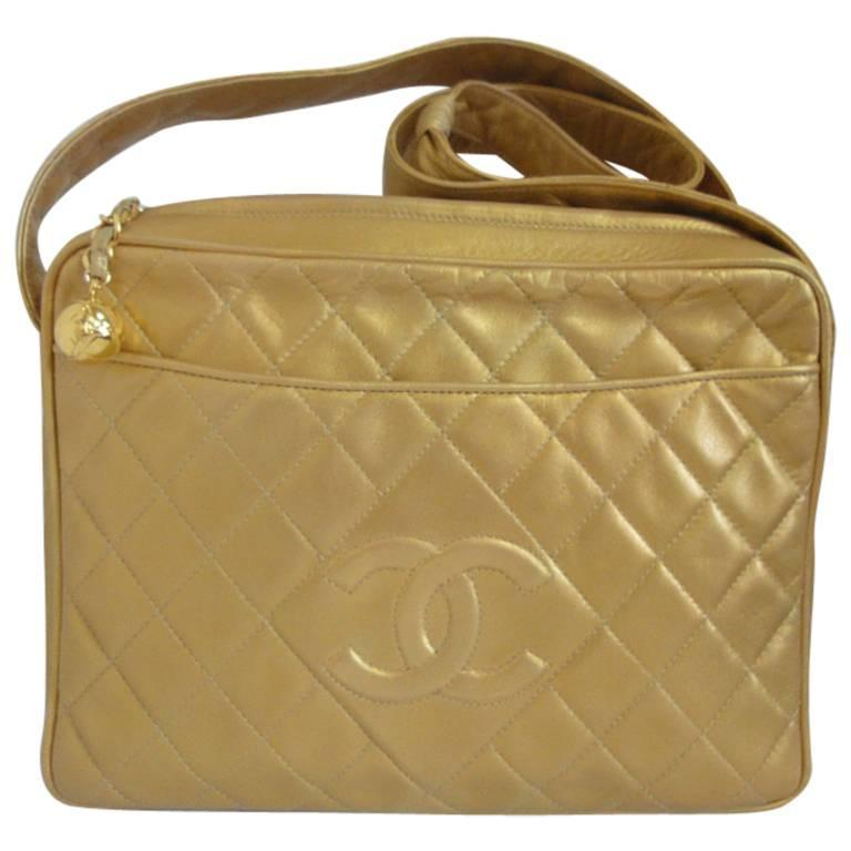 Vintage CHANEL golden lamb leather shoulder bag with CC mark and cc charm. 1