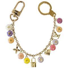 LOUIS VUITTON Logo Bag Charm Pastilles Gold and Pastels