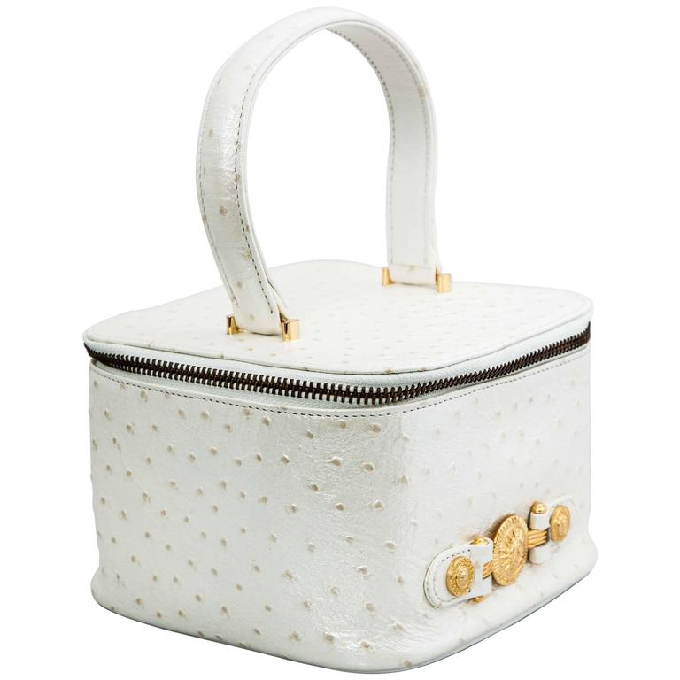 Very rare Versace white faux ostrich vanity case bag in white and gold.  It has a mirror inside. From the 1990's, never been used.