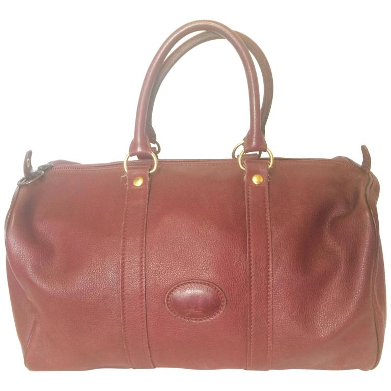 80's Vintage Longchamp rare dark wine leather duffle bag, mini travel purse.  For Sale