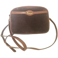 Vintage Gucci brown suede oval shape shoulder purse with riri zippers.