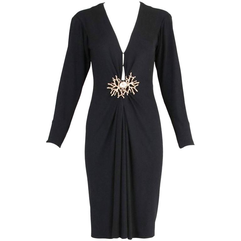 Yves Saint Laurent black silk jersey deep v-neck cocktail dress with oversized clasped coral & rhinestone closure at front. In excellent condition. Size tag 34 - please see measurements. MEASUREMENTS: Bust - 32