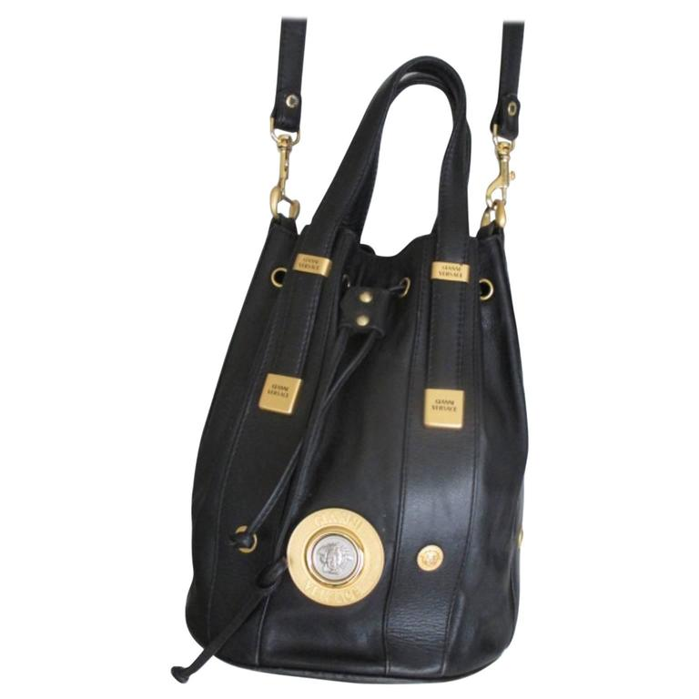 44d72020356d Gianni Versace black leather bag with gold medusa at 1stdibs