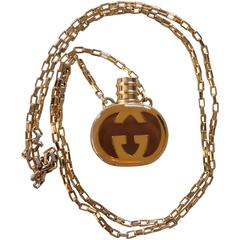 Vintage Gucci gold and brown round shape perfume bottle necklace