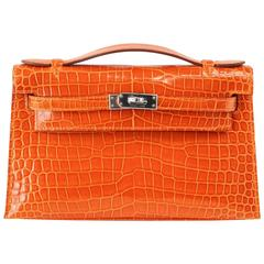 HERMES Kelly Pochette Clutch Bag Orange Feu Porosus Crocodile Palladium Rare