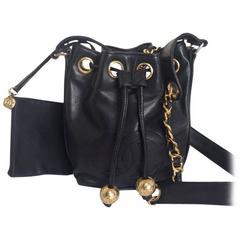 Vintage CHANEL black lamb leather mini hobo bucket drawstring shoulder bag.