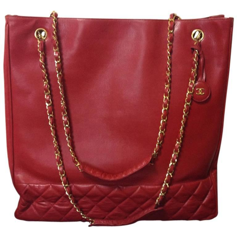 Vintage CHANEL lipstick red leather large tote bag with golden chains and cc.