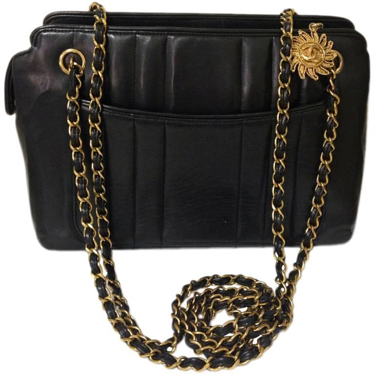 Vintage CHANEL black lambskin chain shoulder bag in vertical stitch, flower cc 1