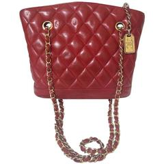 Vintage CHANEL lipstick red lamb leather trapezoid shape tote bag with cc motif.