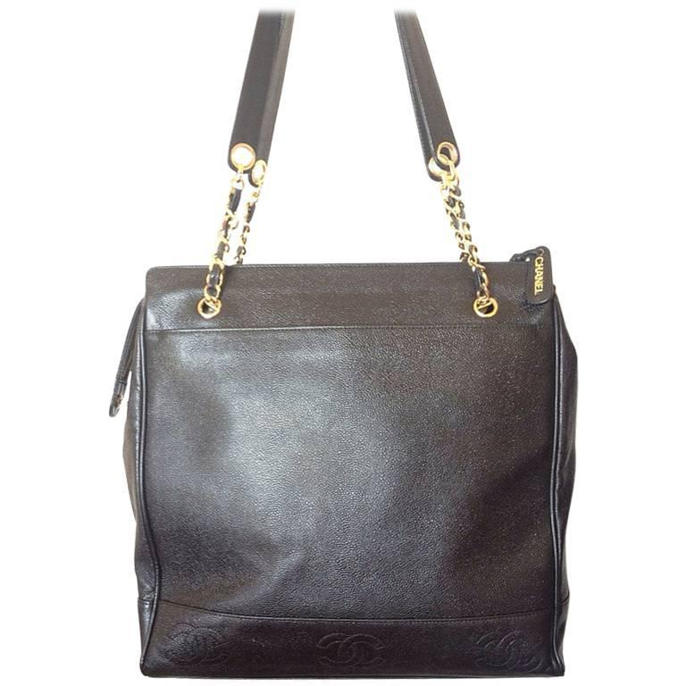 Vintage CHANEL black caviar leather shoulder tote bag with cc stitch marks.