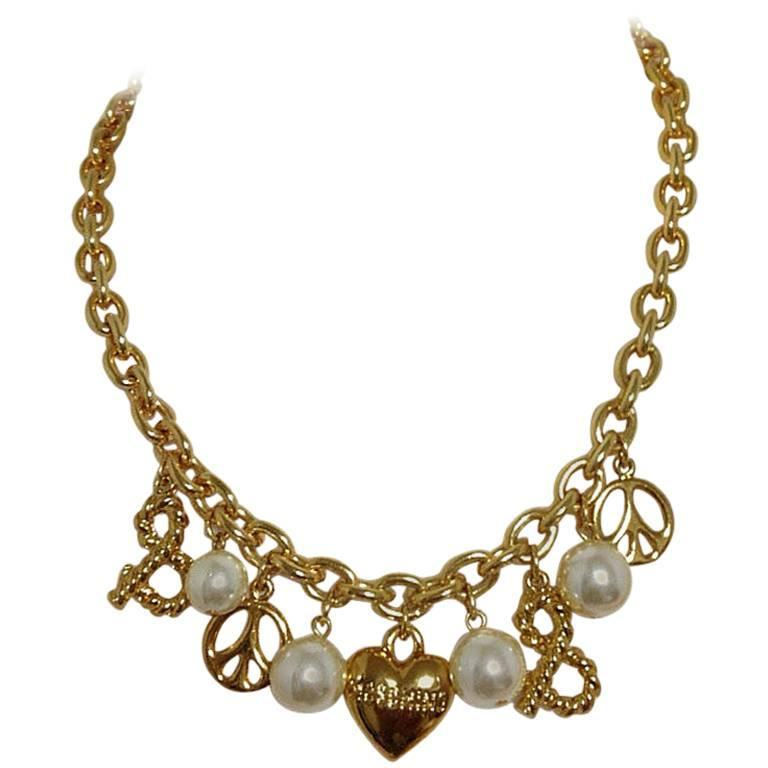 MINT. Vintage Moschino statement necklace with heart, peace mark, faux pearls.  1