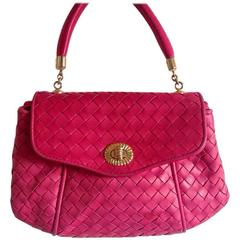 Vintage Bottega Veneta classic intrecciato woven leather handbag in hot pink.