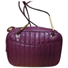 Vintage FENDI wine red lambskin leather shoulder bag with golden logo charm pull