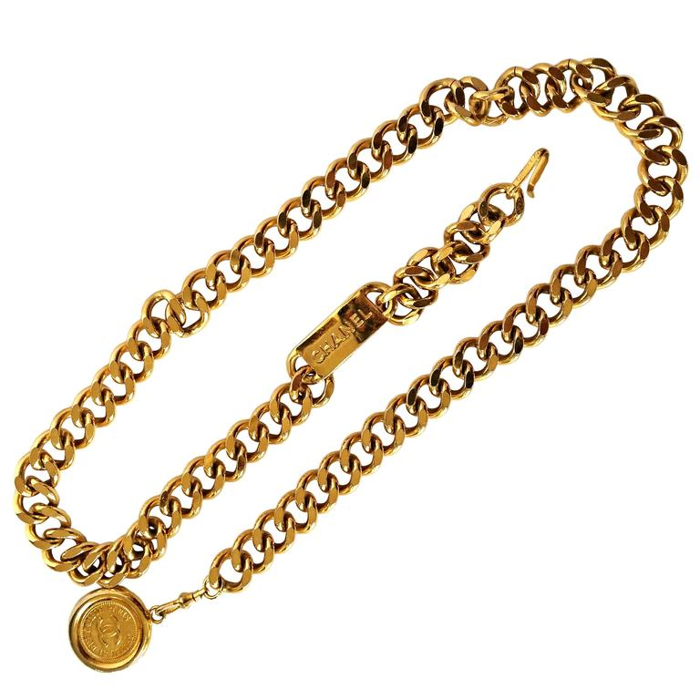 Vintage CHANEL golden thick chain belt with a golden CC charm and logo plate.  1