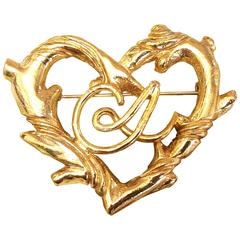 Vintage Christian Lacroix large golden heart and arabesque motif brooch, hat pin