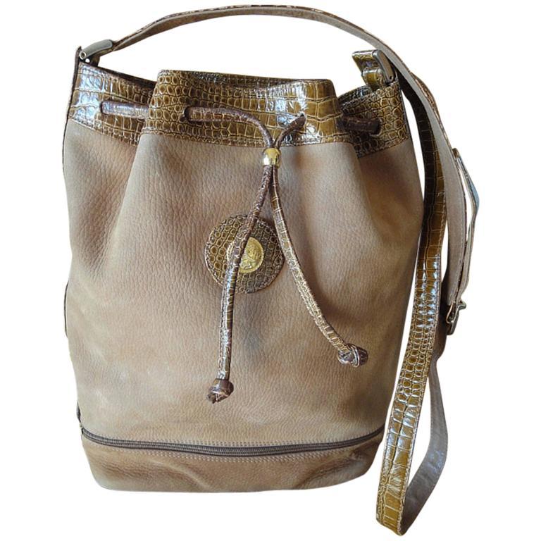 Vintage FENDI tan brown suede leather bucket shoulder hobo bag with Janus motif. 1