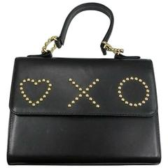 Vintage MOSCHINO black leather handbag in classic kelly purse style. Heart & XO