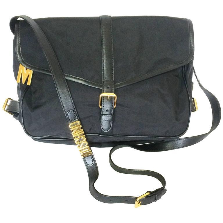 MINT. Vintage Moschino black nylon saumur messenger shoulder bag with leather
