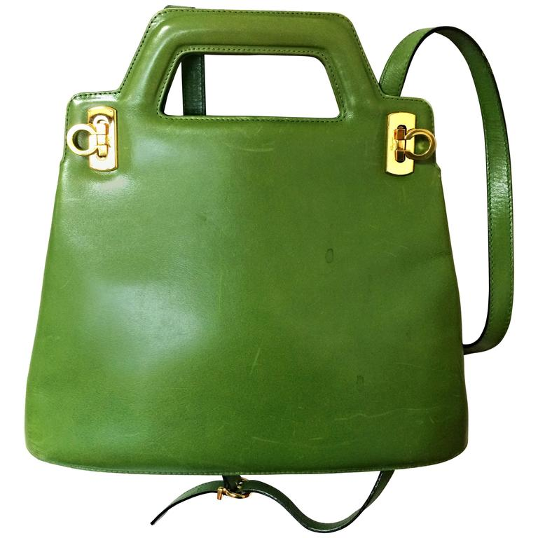 Vintage Salvatore Ferragamo green leather golden gancini trapezoid shape handbag 1