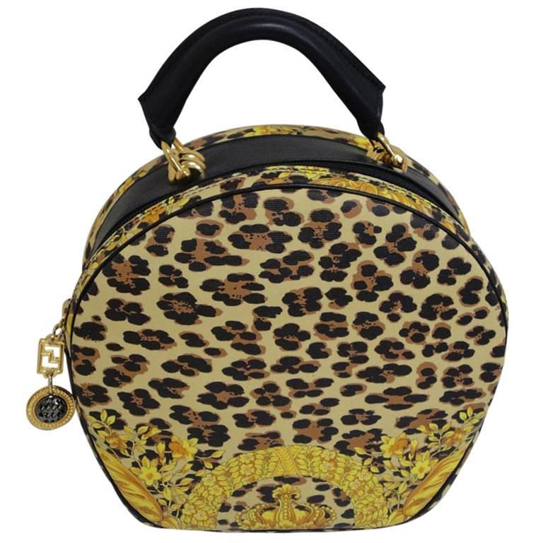 MINT. Vintage Gianni Versace leopard and gorgeous print round bag with strap. 1