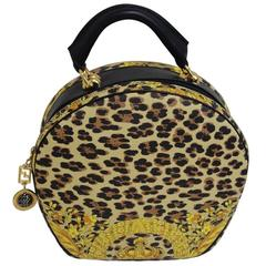 MINT. Vintage Gianni Versace leopard and gorgeous print round bag with strap.
