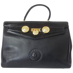 Vintage Gianni Versace genuine black leather Kelly style bag with Sunburst motif