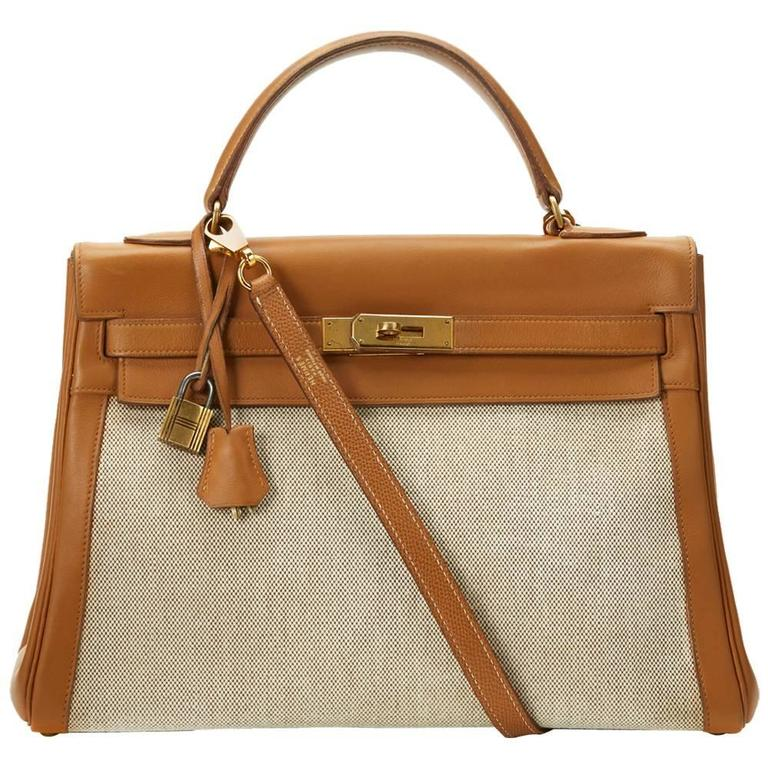 1950s Hermes Tan Leather and Canvas Vintage Kelly Retourne 32 For Sale.