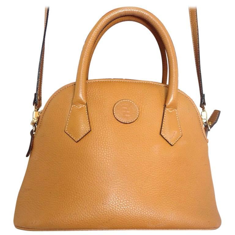 Vintage FENDI tanned brown leather bolide style bag with shoulder strap.