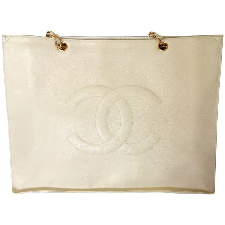 Vintage CHANEL ivory white caviar large tote bag, shopper bag with chains. For Sale