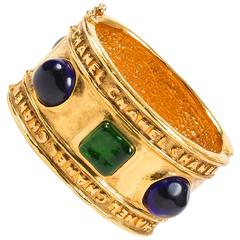 Vintage Chanel Gold Tone Hammered Blue Green Stone Embellished Cuff Bracelet