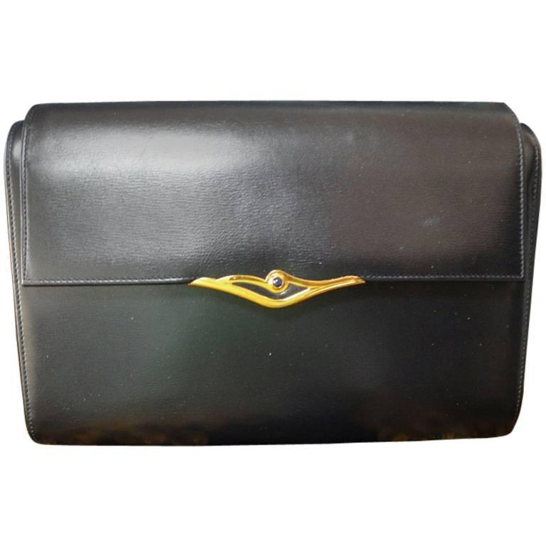 Vintage Cartier black navy  leather classic shape clutch bag with blue stone. For Sale