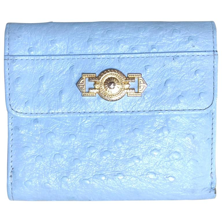 Vintage Gianni Versace ostrich-embossed light blue leather wallet with sunburst For Sale