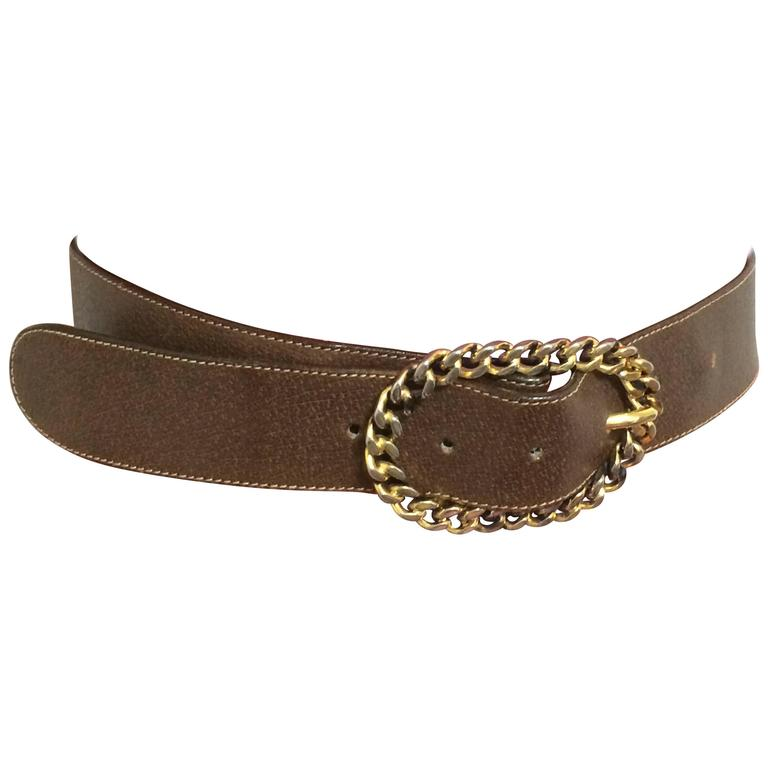 Vintage Gucci dark brown leather belt with detachable golden chain buckle.