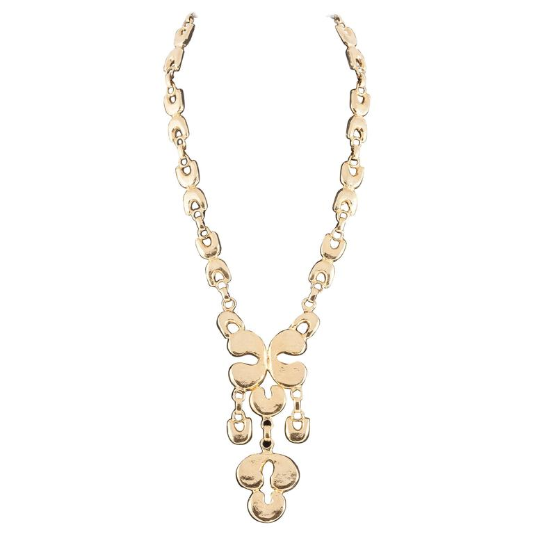 mimi de n dramatic gilt metal pendant necklace 1972