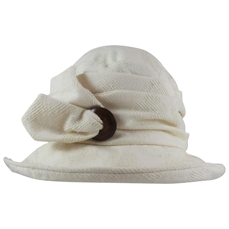 Suzanne Couture Millinery Ivory Cloth Floppy Hat with a Wooden Button