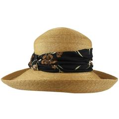 Suzanne Couture Millinery Tan Straw Hat with Black Floral Ribbon