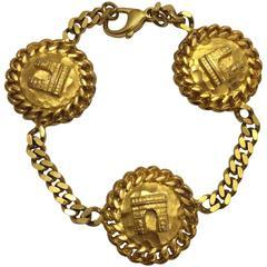 Celine 1990s Gold Tone Paris Arc de Triomphe Medallion Coin Chain Charm Bracelet