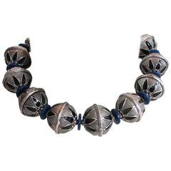 Masha Archer White Metal Blue Wreath Necklace