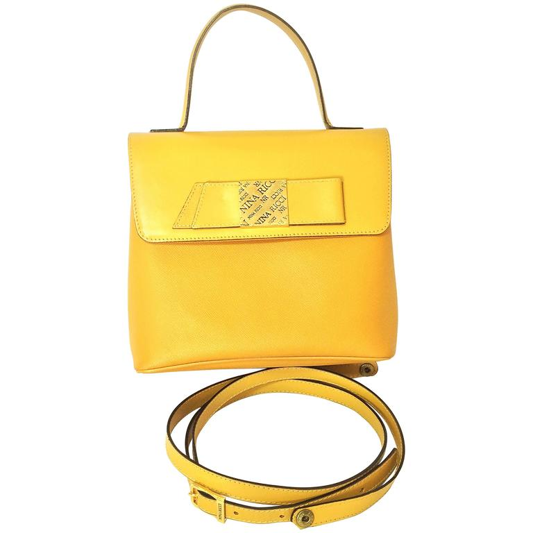 MINT. Vintage Nina Ricci yellow leather handbag purse with shoulder strap. For Sale