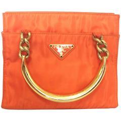 Vintage PRADA orange nylon mini tote bag with golden chain and metallic handles.