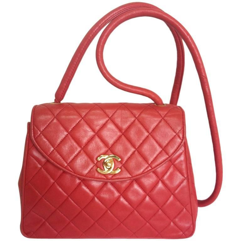 Vintage CHANEL lipstick red lamb leather shoulder bag with leather strap and cc.